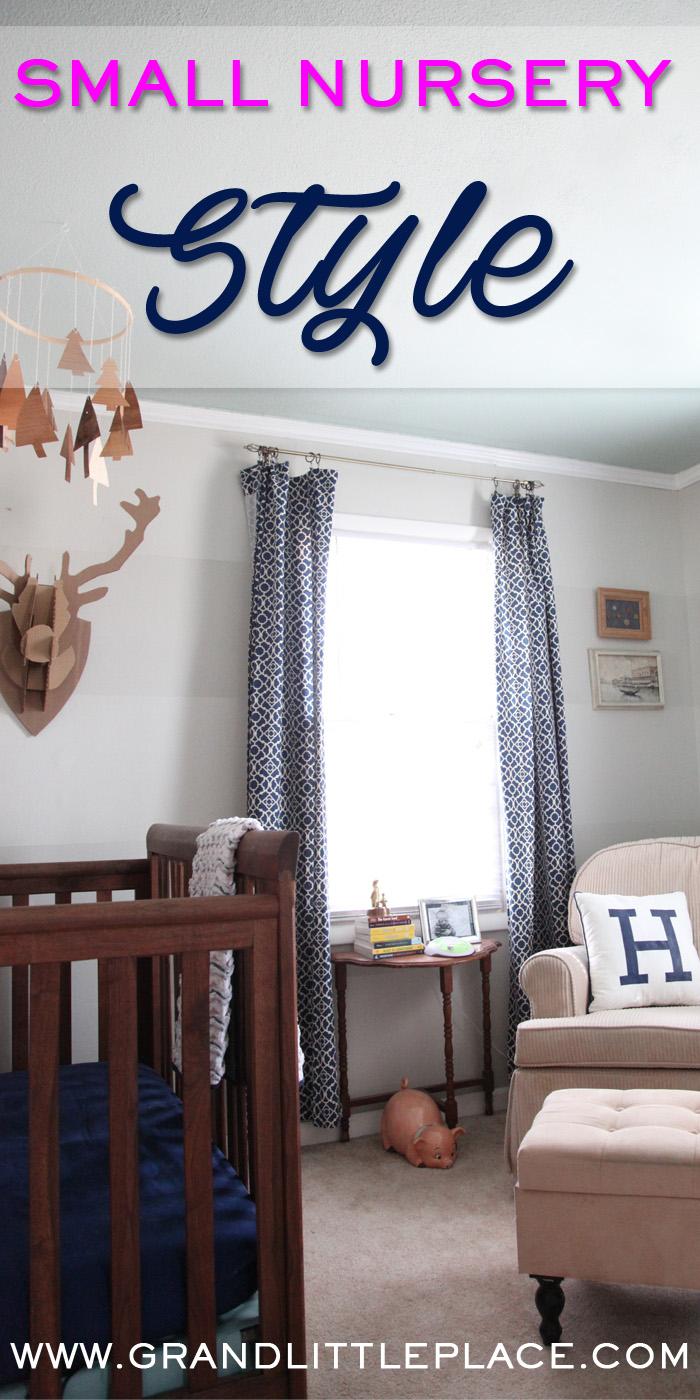 Cardboard taxidermy against grey tone on tone striped walls above a custom built walnut crib with inlaid monogram.
