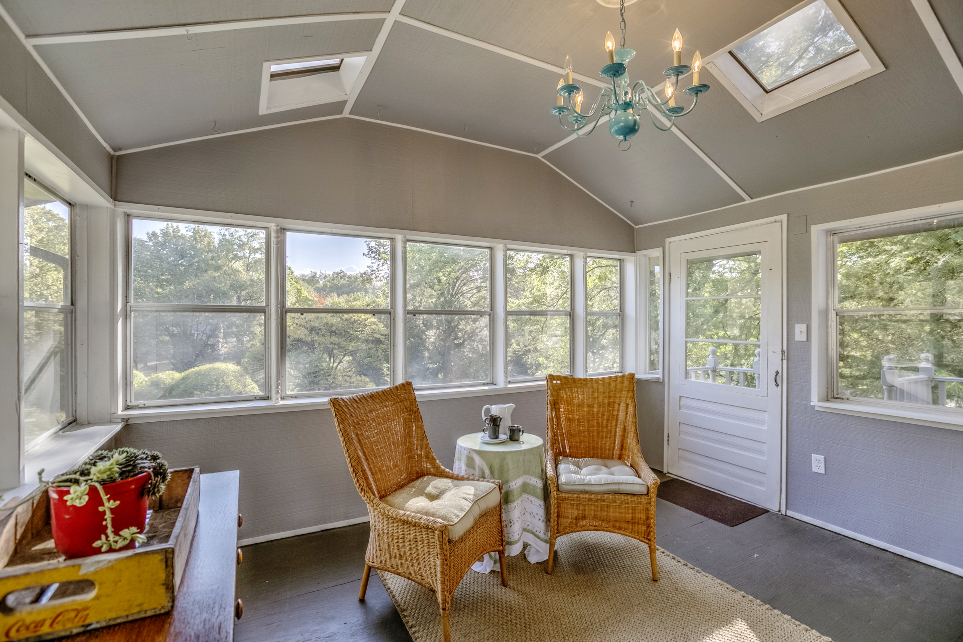 Tell a story with your staging. This sun room was set simply with two chairs and a table. The table had a coffee pot and cups.