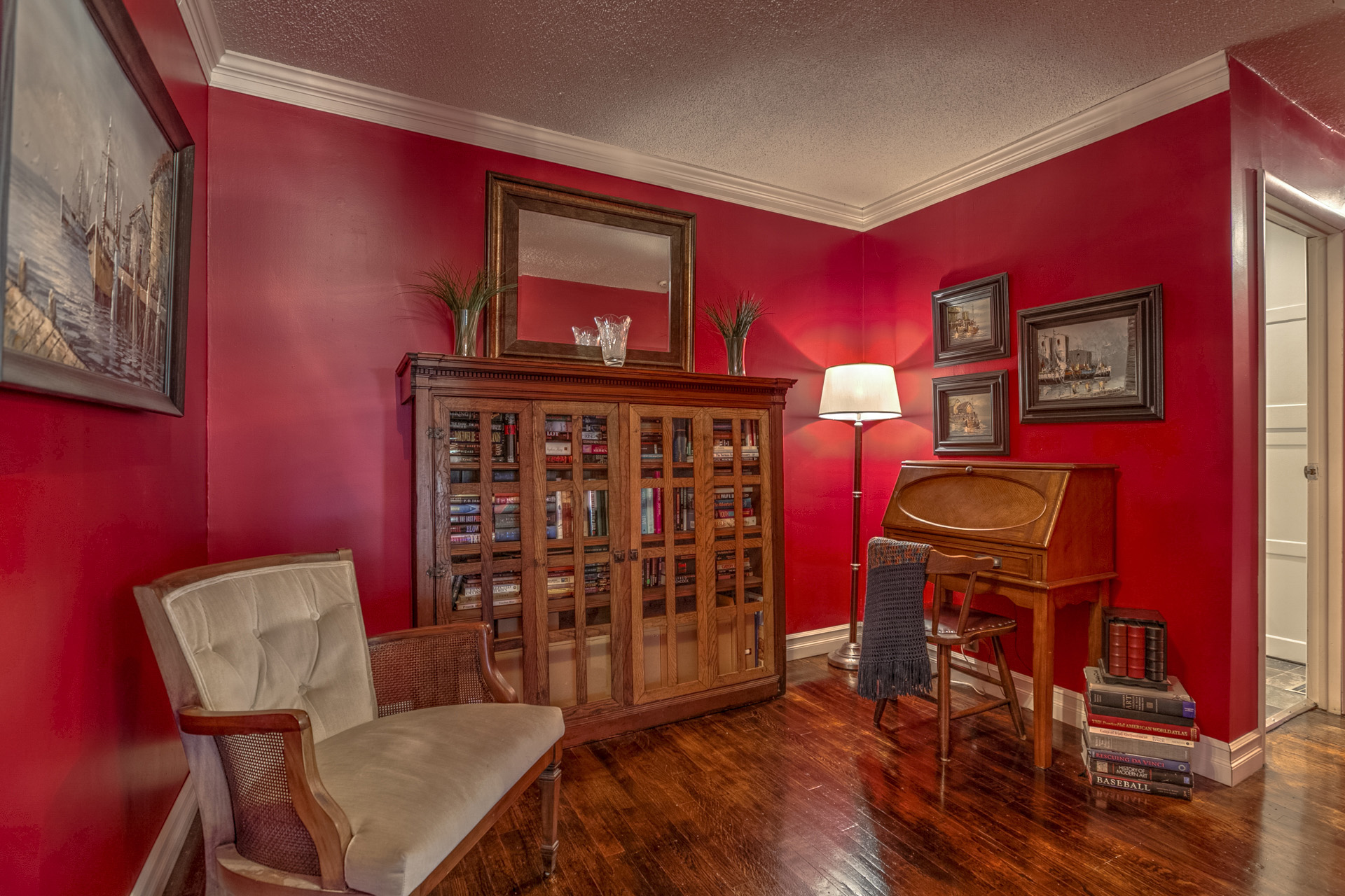 Home Sitting Room with Red Walls and Antique Bookcase