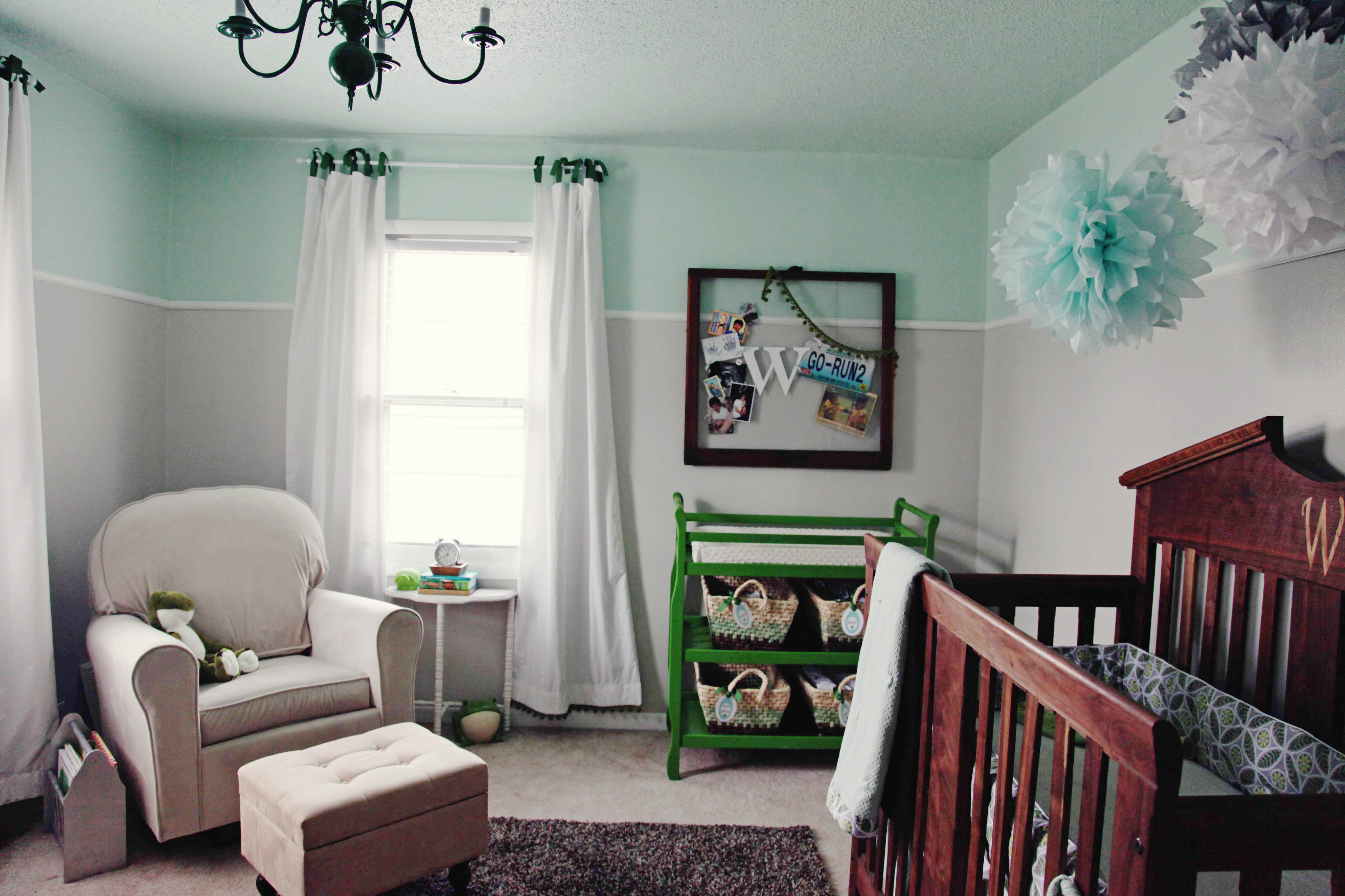two tone nursery with green DIY pom pom curtains and green painted changing table