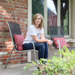 Blogger sitting on front porch
